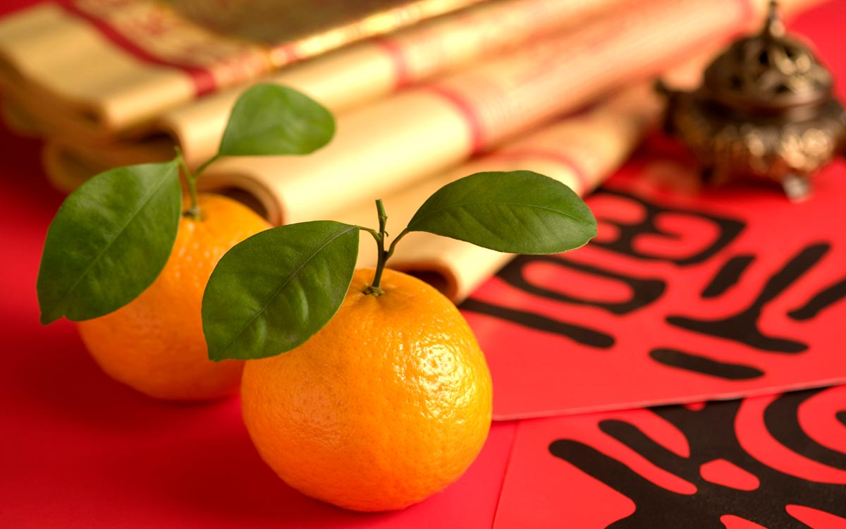 Мандарины - символ Китайского Нового года. Фото с сайта hinlingo.com